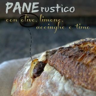 Pane rustico con olive, limone, acciughe e timo